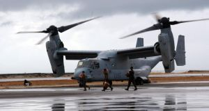 A US Bell Boeing V-22 Osprey arrives at the airport to transport humanitarian workers to typhoon affected areas Tacloban today to help people affected by  Typhoon Haiyan. Photograph: Jeoffrey Maitem/Getty Images