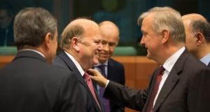 Michael Noonan with EU Commissioner for Economic and Monetary Affairs, Olli Rehn yesterday. Photograph:  Peter Cavanagh