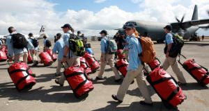 Members of the Australian National Critical Care and Trauma response team arrive in Tacloban on Thursday to help people affected byTyphoon Haiyan. Photograph:  Jeoffrey Maitem/Getty Images