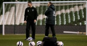 Ireland manager Martin O'Neill with assistant Roy Keane during last night's training session at the Aviva Stadium. Photograph: Brian Lawless/PA
