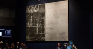 Andy Warhol's artwork 'Silver Car Crash (Double Disaster)' is displayed while being auctioned at Sotheby's.  Photograph: Andrew Burton/Getty Images