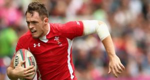 Cory Allen of Wales breaks away to score a try against Canada at the 2013 Hong Kong Sevens. Photograph: Mark Kolbe/Getty Images