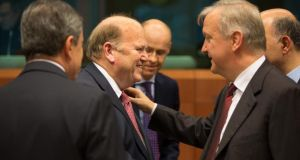 Michael Noonan with EU commissioner for economic and monetary affairs Olli Rehn in Brussels yesterday. Photograph: Peter Cavanagh
