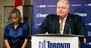 Toronto Mayor Rob Ford speaks at a news conference with his wife Renata (L) at City Hall in Toronto last night. Ford, under pressure to resign after he admitted smoking crack and buying illegal drugs, said  he was receiving professional help for drinking problems, but gave no hint he might step down. Photograph: Mark Blinch/Reuters.