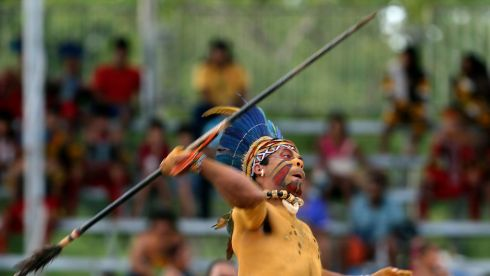 A member of a Brazilian indigenous ethnic group Pataxo competes in the spear throwing competition during the XII Games of the Indigenous People in Cuiaba. Forty-eight Brazilian indigenous tribes are presenting their cultural rituals and competing in traditional sports such as archery, running while carrying logs and canoeing during the XII Games of Indigenous People. Photograph: Paulo Whitaker/Reuters