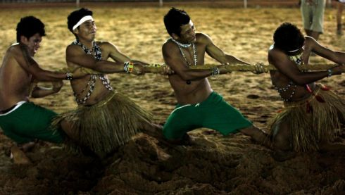 Members of Brazilian indigenous ethnic group Guarani Kaiwa compete in a tug-of-war competition. Photograph: Paulo Whitaker/Reuters