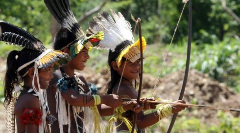 Brazilian indigenous children play with bows and arrows during the XII Games of the Indigenous People. Photograph: Paulo Whitaker/Reuters