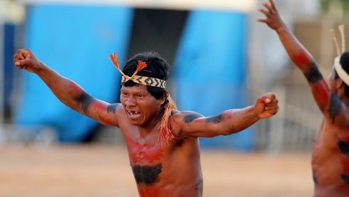 A Kanela-Ramkokamekra tribe member reacts after doing the business in a tug-of-war. Photograph: Paulo Whitaker/Reuters