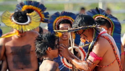 Manoki people amid a ritual where a child is acknowledged as an adult. Photograph: Paulo Whitaker/Reuters