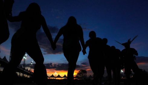 Dancing into the night. Photograph: Paulo Whitaker/Reuters
