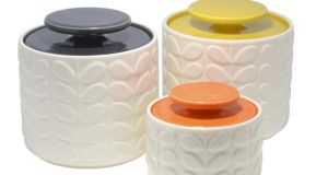 THREE OF A KIND . . . SMART STORAGE Orla Kiely's Stem print has become a victim of its own success – it has become so popular that fans have started to fall out of love with it. This new cleaner version has a raised white glaze moulded pottery-finish kitchen storage jars and high gloss colour glazed lids(above). The inside of each pot is also glazed in the same high gloss colour, making for a striking contrast with the white exterior. The lids have rubber air-tight sealing rings. The one-litre storage jars, 13cm by 13.5cm, come in charcoal, orange and yellow, and cost €29.95 at all branches of The Kilkenny Shop (kilkenny shop.com). The smaller, orange-lidded sugar pot, 9cm by 9.5cm, costs €25.95. This Boho owl tea caddy tin, €17 (left), is just one of several stylish options at Marks and Spencer (marksandspencer.ie). Check out the very robin motif tins and their very cool typography printed cake tins, €35 for a set of two.