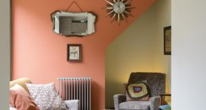 The feature wall in the cozy room is painted a soft burnt orange, called Heat, by Little Greene Paint Company, whose stockists include MRCB, Stillorgan Decor, Fuller Paints, TileStyle and Salmon Interiors.