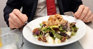 Simon Coveney takes our reporter's lunch at the request of the photographer, who thinks the salad is more photogenic than what the Minister has ordered. Photograph: Eric Luke