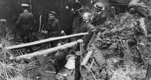 'It was not always quiet here on the northern banks of the River Somme. The British and German armies battled, to and fro, for every inch of sodden land from 1914 to 1918.' Above, David Lloyd George  acknowledges cheers from British troops as he emerges from a captured German dug-out at Fricourt in September 1916. Photograph: Hulton Archive/Getty Images