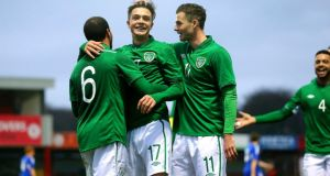Republic of Ireland's Jack Grealish (centre) celebrates scoring his side's third goal with Samir Carruthers and Anthony Forde during the Uefa under-21 qualifier at The Showgrounds in Sligo. Photograph:   James Crombie/Inpho