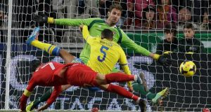 Portugal's Cristiano Ronaldo scores the only goal of the game  past Sweden goalkeeper Andreas Isaksson during their World Cup qualifying play-off first leg game in Lisbon. Photograph: Armando Franca/AP Photo