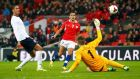 Chile's Alexis Sanchez  clips the ball past scores past England's goalkeeper Fraser Forster to score his second goal while  Chris Smalling looks on during last night's international friendly   at Wembley Stadium in London. Photo: Darren Staples/Reuters