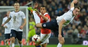 England's Phil Jones (right) will miss Tuesday's game against Germany. Photograph: Toby Melville/Reuters