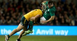 Ireland's Fergus McFadden is tackled by Australia's Michael Hooper during the Guinness Series match at the Aviva Stadium.  Photograph: Brian Lawless/PA Wire
