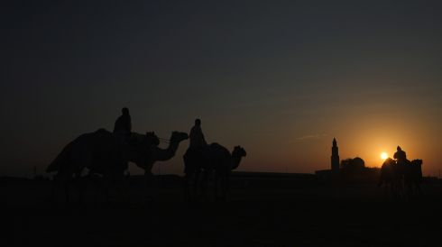 Heading past a mosque at dusk. Photograph: Christopher Furlong/Getty Images