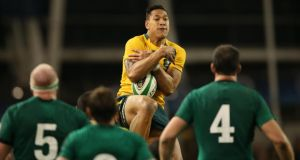 Australia's Israel Folau uses those size 13 feet to rise high and claim yet another kick against Ireland at the Aviva Stadium on Saturday. Photograph: Billy Stickland/Inpho