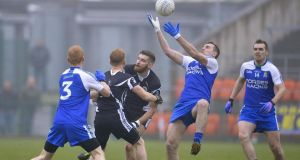 Kilcoo's James Conway wins the ball ahead of  Ballinderry's Paul Greenan. Photograph: Russell Pritchard/Inpho/Presseye