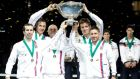 Left to right, Radek Stepanek, Lukas Rosol, team captain Vladimir Safarik, Tomas Berdych and Jan Hayek of the Czech Republic hold the winner's trophy aloft after beating  Serbia in the  Davis Cup World Group Final  at Kombank Arena  in Belgrade, Serbia. Photograph:  Srdjan Stevanovic/Getty Images.