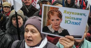 Supporters of jailed former Ukrainian prime minister and opposition leader Yulia Tymoshenko during a rally in front of the parliament building in Kiev. Photograph: Sergii Polezhaka/Reuters
