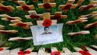A photograph of Drummer  Lee Rigby of the Royal Regiment of Fusiliers is pictured in the Field of Remembrance at Westminster Abbey in London on November 9th. Photograph: Reuters
