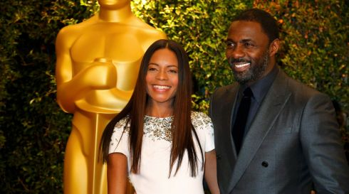 Naomie Harris with Luther star Idris Elba. Photograph: Fred Prouser/Reuters