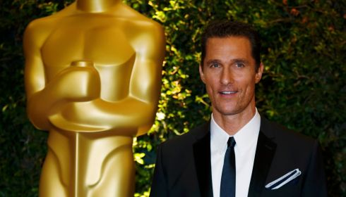 Yet another picture taken beside a golden statue. Matthew McConaughey this time. Photograph: Fred Prouser/Reuters