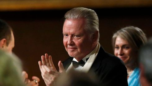 Jon Voight applauds as his daughter Angelina Jolie is announced recipient of the Jean Hersholt Humanitarian Award. Photograph: Mario Anzuoni/Reuters