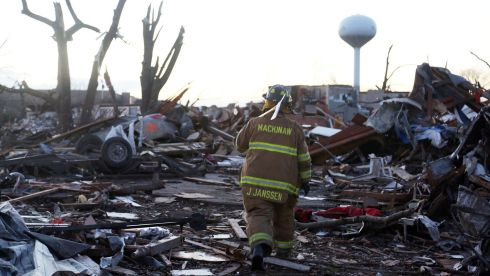 Jeremy Janssen of Mackinaw Fire Department trudges through debris in Washington. Photograph: Tasos Katopodis/Getty Images