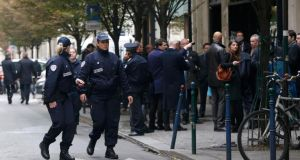 French police officers cordon the area next to newspaper Libération's headquarters in Paris today. Photograph: Reuters