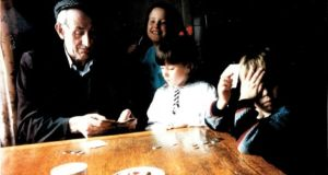 Tea and cards: Emma Somers (in white) with her grandfather, Michael Somers, and her cousins Lisa and Tom O'Riordan. Photograph: Mary Somers