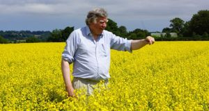 Jack Rogers of Newgrange Gold, one of Ireland's largest seed oil producers, with last summer's crop of rapeseed