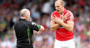 Cork's Alan O'Connor (right) has announced his retirement. Photograph: James Crombie/Inpho