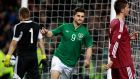 Ireland's Shane Long  celebrates his late strike against Latvia.