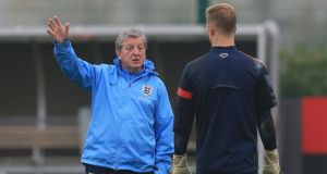 England Manager Roy Hodgson  with goalkeeper Joe Hart during yesterday's training session at London Colney, Hertfordshire.