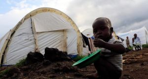 A Congolese refugee child eats a warm meal at the Nyakabande refugees transit camp in Kisoro district, 491 km (305 miles) west of Ugandan capital Kampala. Photograph: Reuters