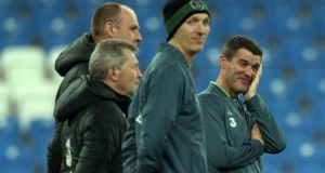 Republic of Ireland assistant manager Roy Keane (right)  enjoys a lighter moment during last night's squad training session  at the Municipal Stadium in Poznan, Poland. Photograph: Donall Farmer/Inpho