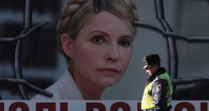 A poster displaying a portrait of jailed former Ukrainian prime minister Yulia Tymoshenko in Kiev. Her case has added to EU-Ukraine tensions. Photograph: Konstantin Chernichkin/Reuters