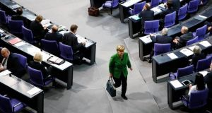 Chancellor Angela Merkel leaves a debate about the surveillance activities of the US National Security Agency. Photograph: Reuters/Thomas Peter