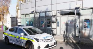 A Garda car outside the Bank of Ireland on the  Stillorgan Road, Montrose, Dublin after an armed robbery today. Photograph:  Collins