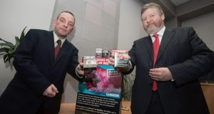 Chairman of the Joint Oireachtas Health Committee Jerry Buttimer (left) and Minister for Health  James Reilly  during a media breifing at Government Buildings where it was announced that Cabinet had approved the General Scheme for the Public Health (Standardised Packaging of Tobacco) Bill 2013.   Photo: Gareth Chaney Collins