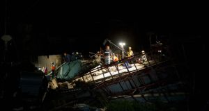 Emergency workers search for survivors after a building collapsed in Tongaat, north of Durban. Photograph: Rogan Ward/Reuters