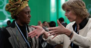 European Commissioner for Climate Action Connie Hedegaard (right) talks with Kenyan delegate Alice Akinyi Kaudia as they attend the Convention on Climate Change  conference at the National Stadium in Warsaw. Photograph:  Kacper Pempel / Reuters