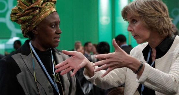 European Commissioner for Climate Action Connie Hedegaard (right) talks with Kenyan delegate Alice Akinyi Kaudia as they attend the Convention on Climate Change conference at the National Stadium in Warsaw. (Credit: Kacper Pempel / Reuters). Click to enlarge.