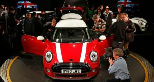 Maximum exposure: the latest edition of the Mini is unveiled at BMW's Oxford plant on Monday. Photograph: Suzanne Plunkett/Reuters