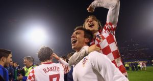 Mario Mandzukic of Croatia celebrates with team-mate Luka Modric  after the  World Cup Qualifier play-off second leg match between Croatia and Iceland at Maksimir Stadium  in Zagreb, Croatia. Photograph: Alex Grimm/Getty Images